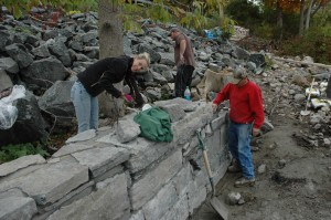 Stone Wall Building with Contractors